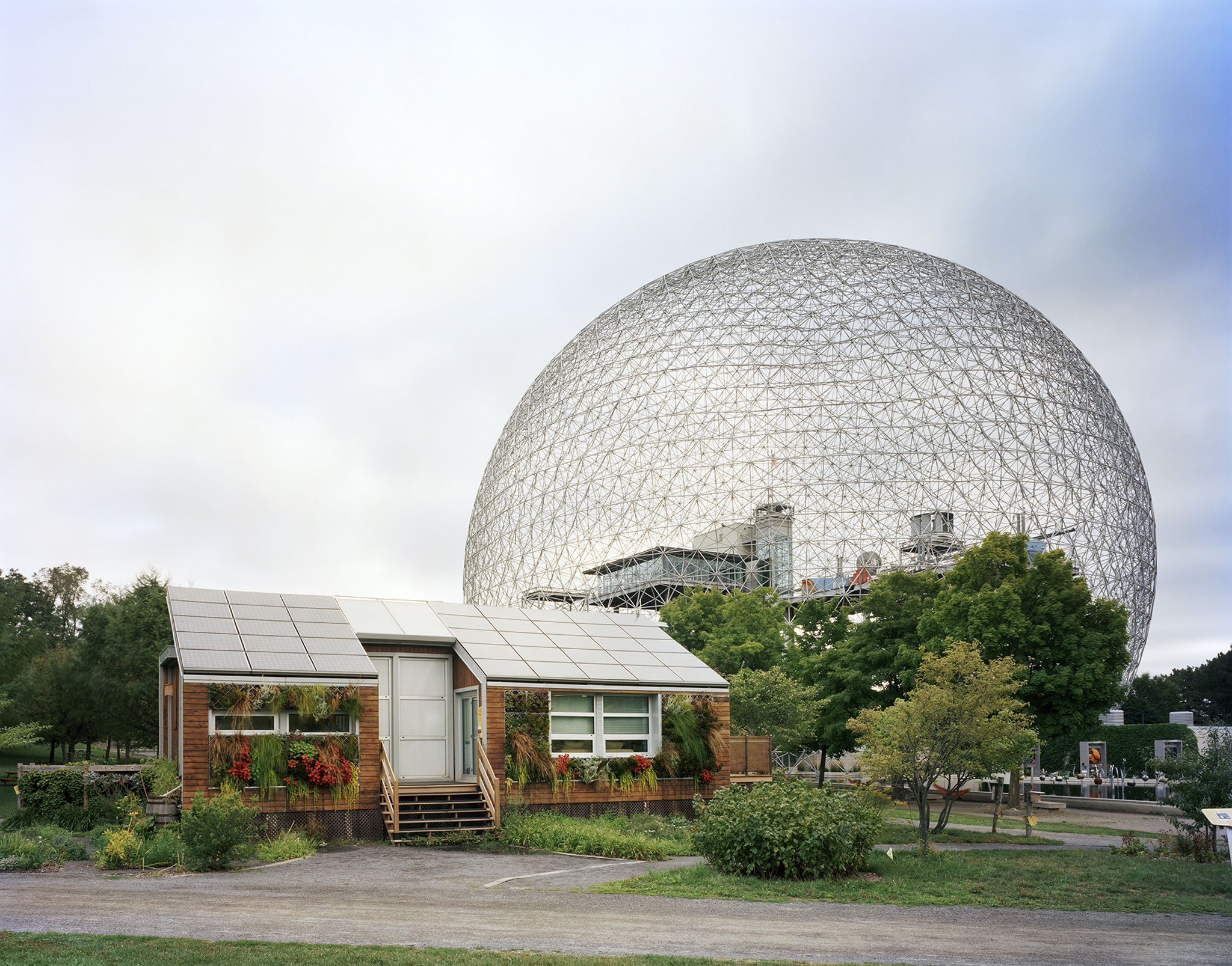 "Montreal 1967 World's Fair, ""Man and His World,"" Buckminster Fuller's Geodesic Dome With Solar Experimental House. Lost Utopias by Jade Doskow at the Front Room Gallery. Courtesy © 2018 Jade Doskow/ Front Room Gallery"