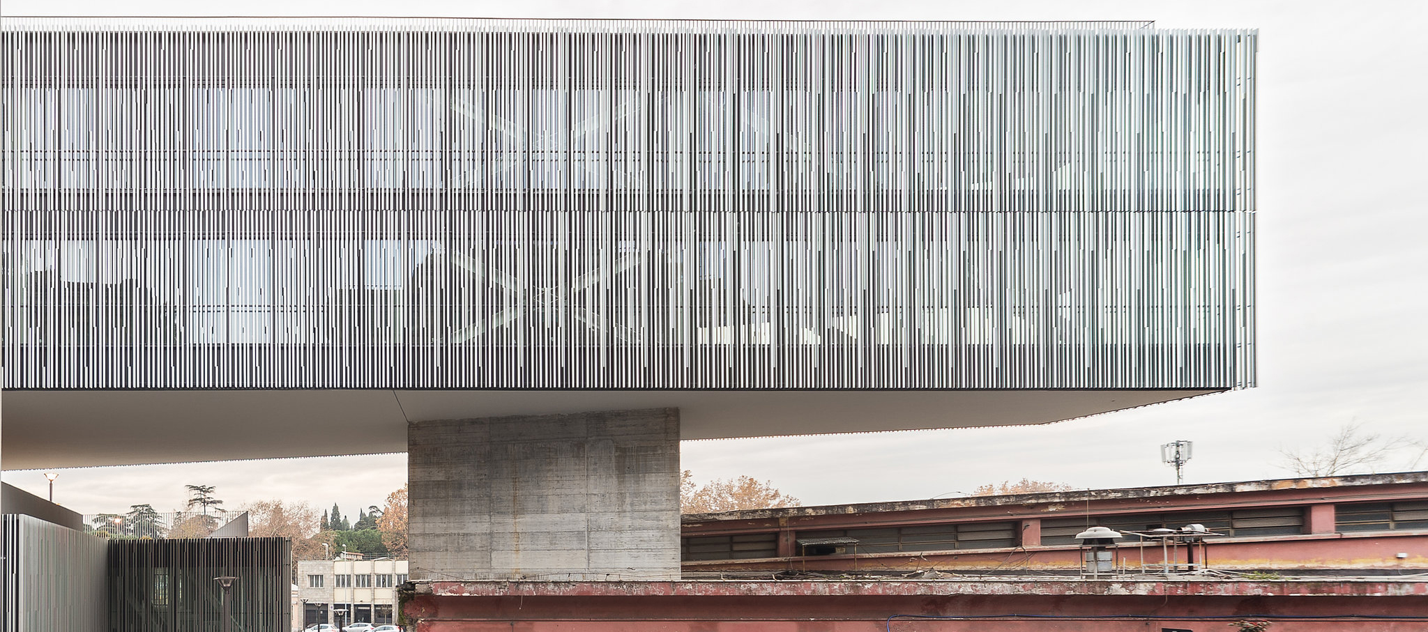 Citta del Sole in Rome, designed by Labics Studio. The project comprises a library and residential, office, retail, parking and public space. Photograph © Marco Cappelletti