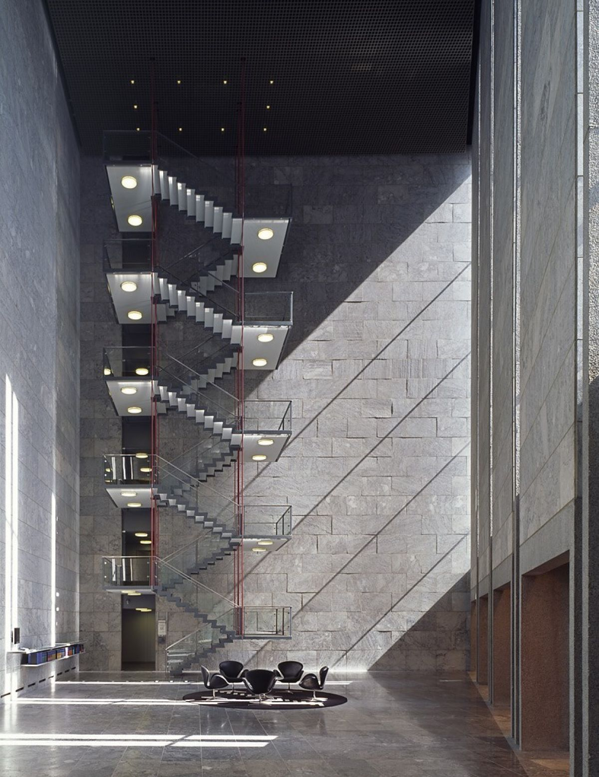 Staircase of the National Bank of Denmark, designed by Arne Jacobsen, in the middle of Copenhagen, between 1966 and 1978. Image courtesy of National Bank of Denmark