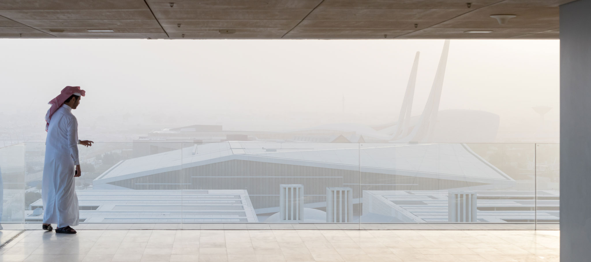 Exterior view from another building. Qatar National Library by OMA. Photograph by Iwan Baan, Courtesy of OMA