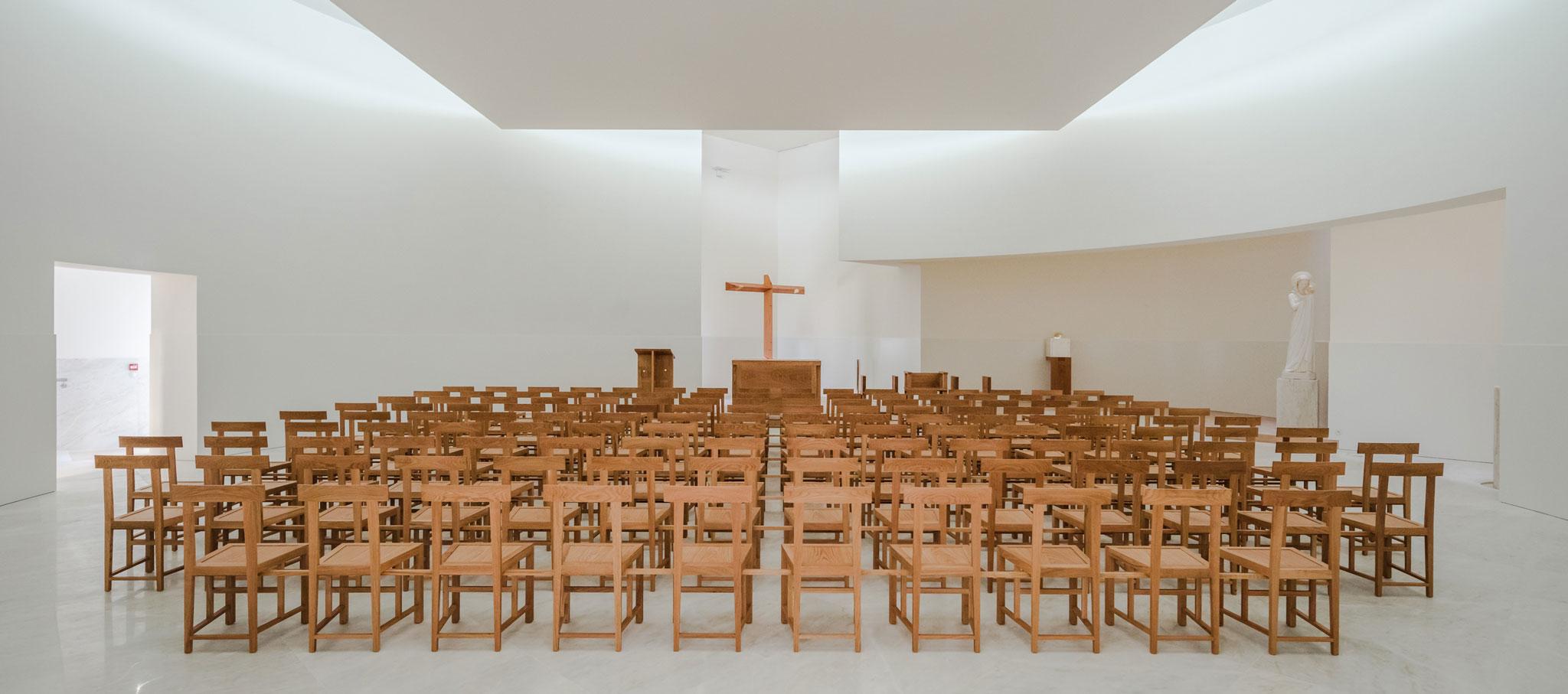 Interior view. Álvaro Siza designs the Saint-Jacques-de-la-Lande church. Photograph © Joao Morgado