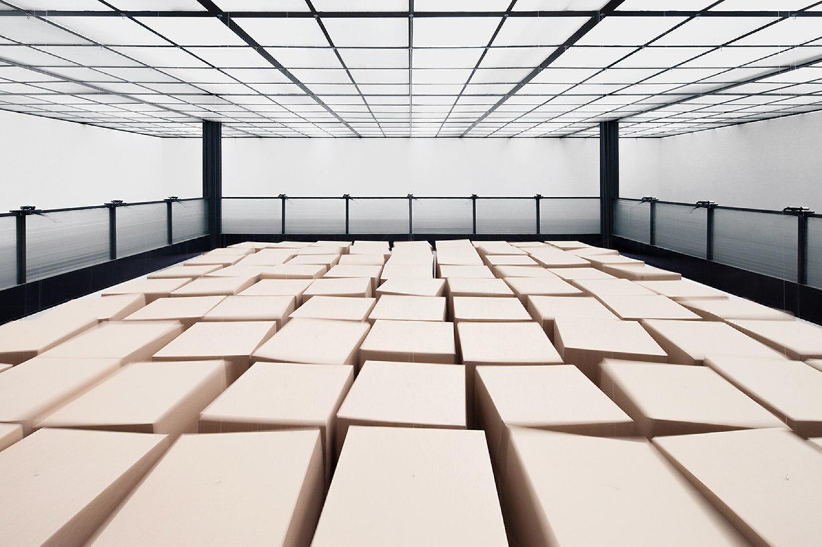 20 prepared dc-motors, 81 cardboard boxes 70x70x70cm. Zimoun & Hannes Zweifel. Image courtesiy of Studio Zimoun.