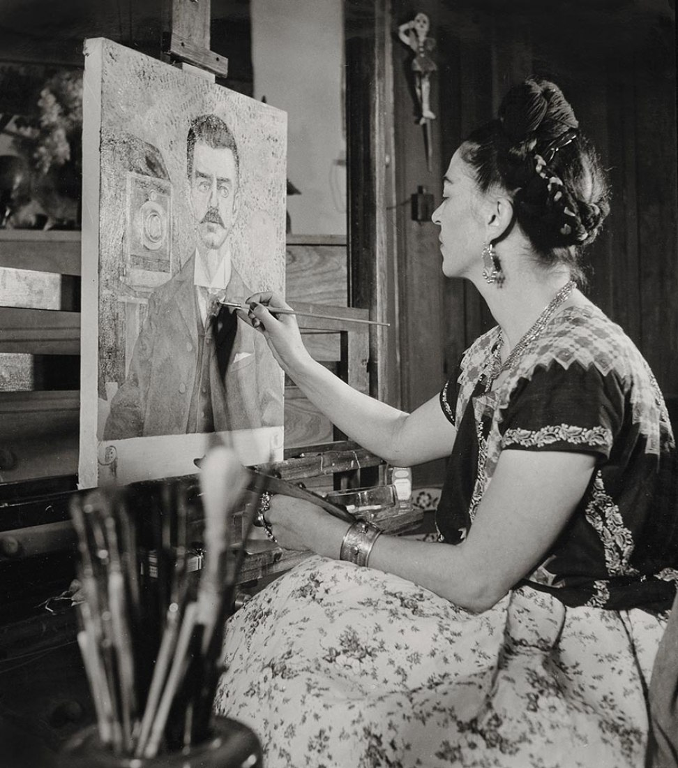 Frida painted her father's portrait by Gisèle Freund 1951. Photograph © Frida Kahlo Museum.