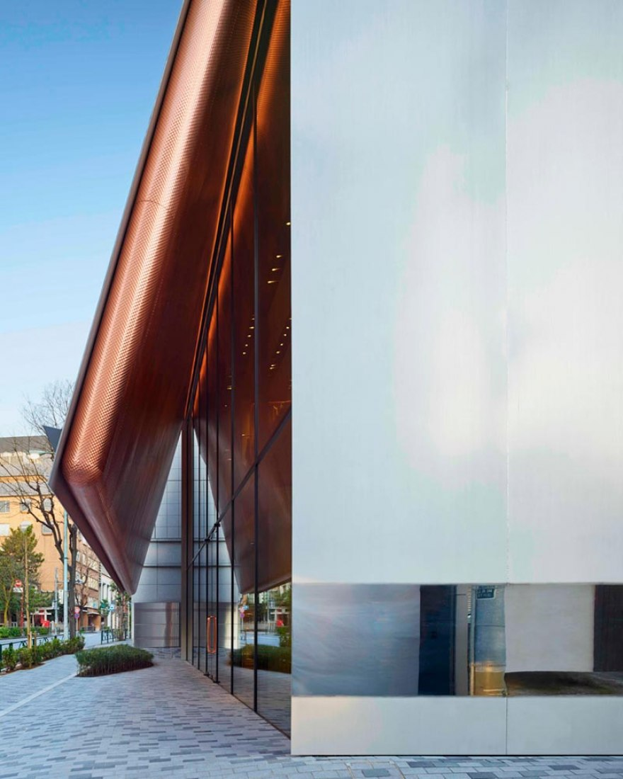 Polished façade draws attention towards the store. Miu Miu Aoyama by Herzog & de Meuron. Images courtesy of Miu Miu.