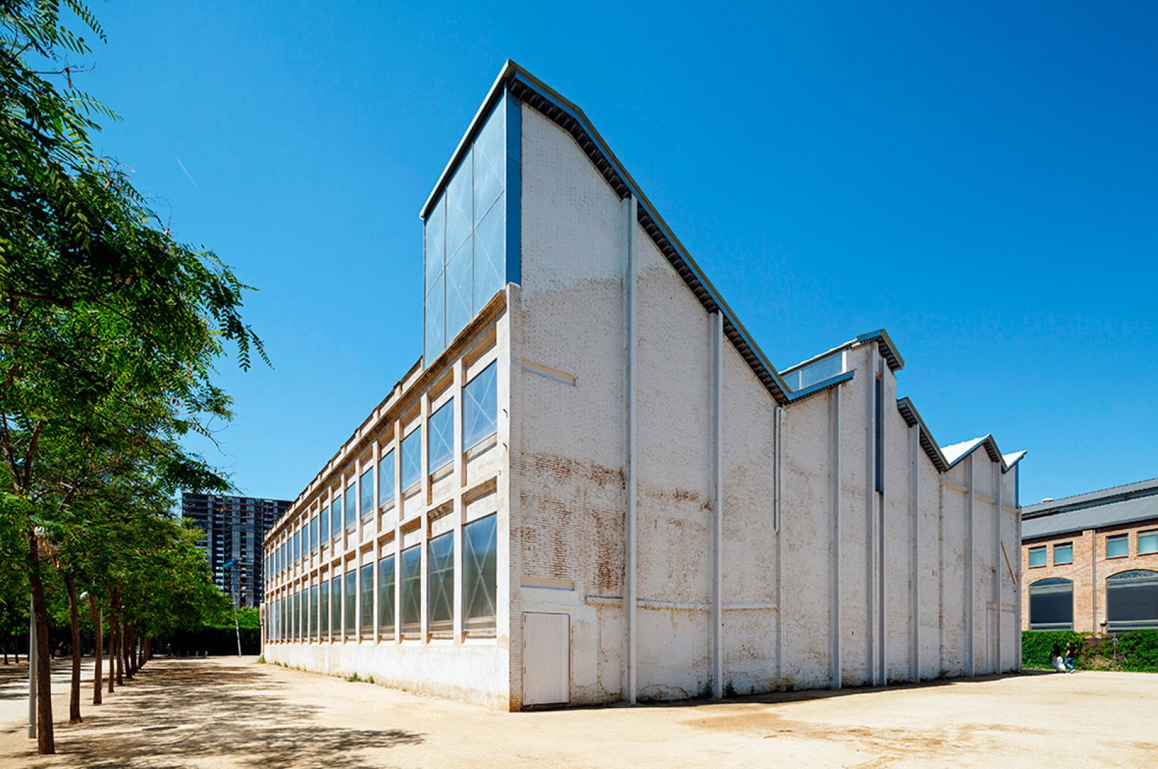 Outside view. Intervention in Oliva Artés factory by BAAS Arquitectura. Photograph © Marcela Grassi. Courtesy of BAAS arquitectura.
