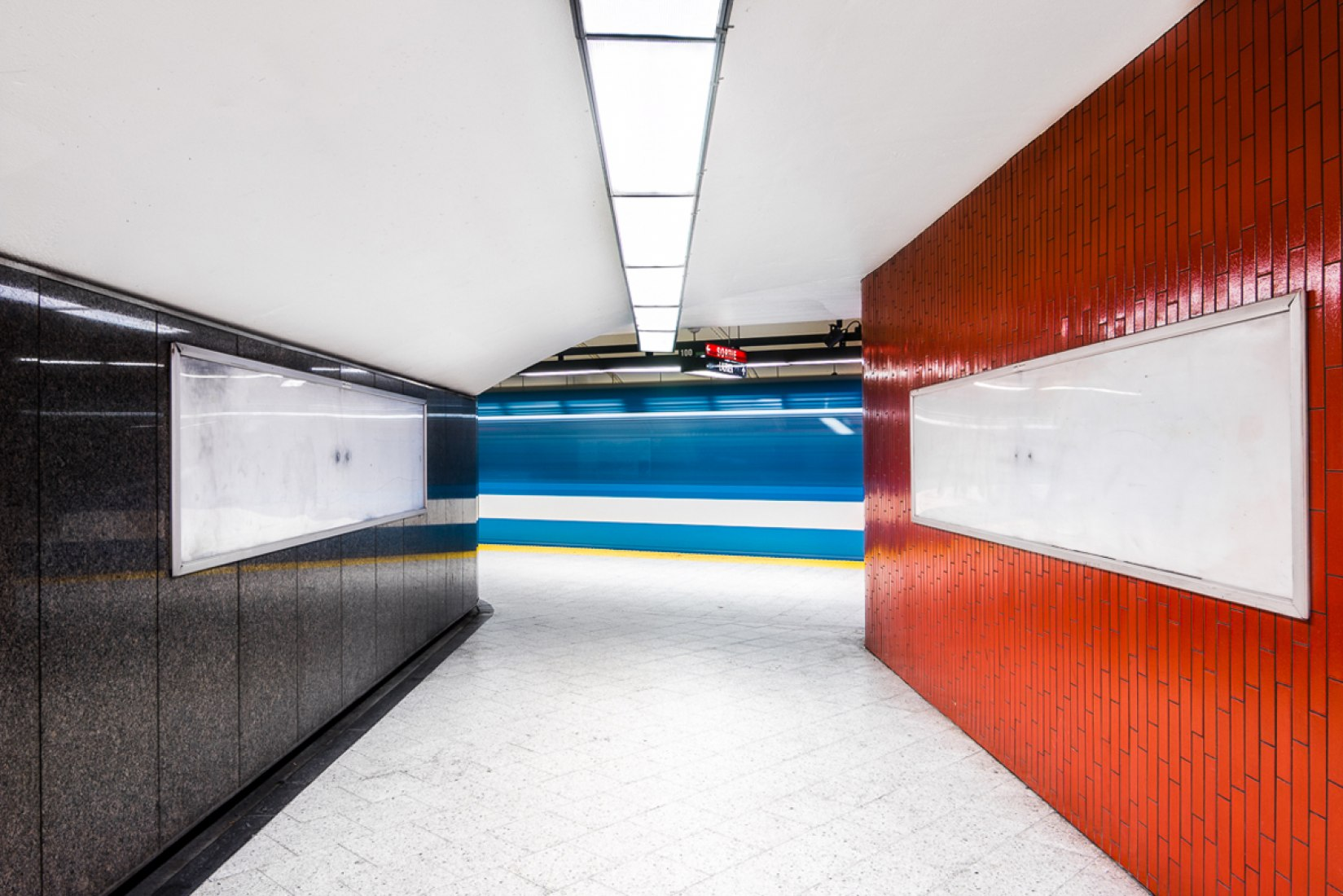 Train crossing through the station. The Montreal Metro Project by Chris M. Forsyth. Photography © Chris M. Forsyth