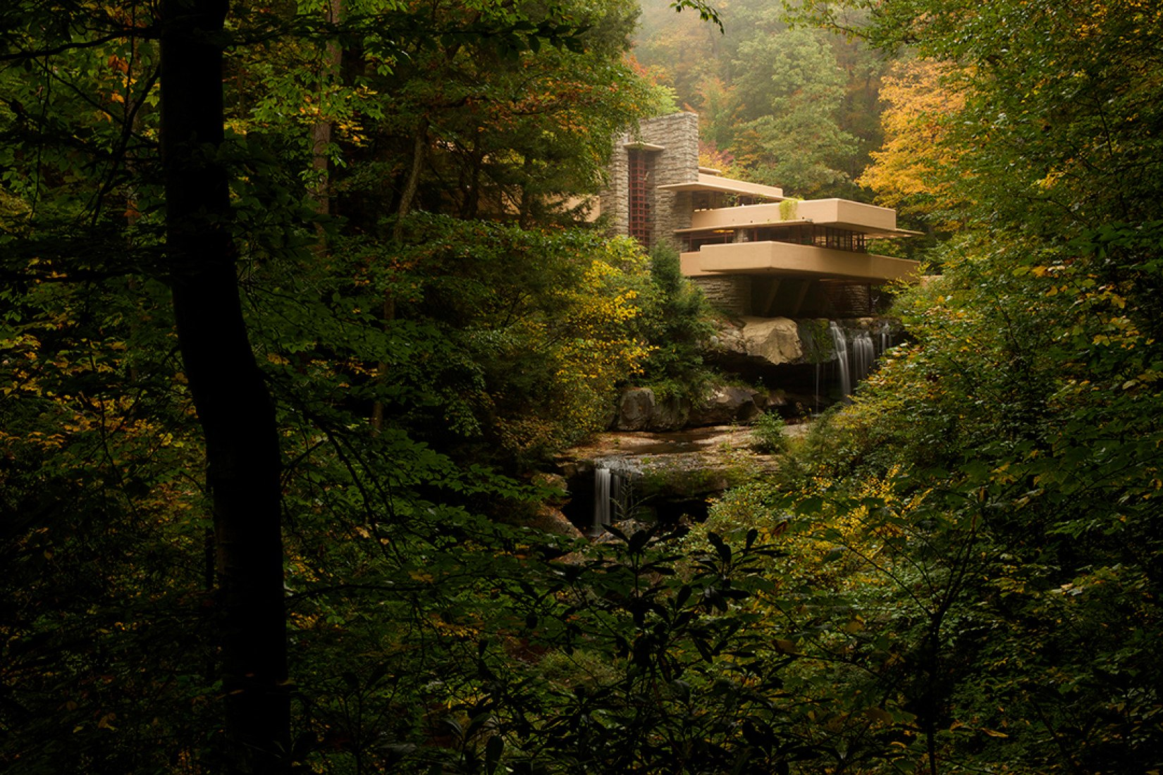 Distant southwestern view. Fallingwater by Frank Lloyd Wright. Photography © Jason Bouwman. Click above to see larger image.