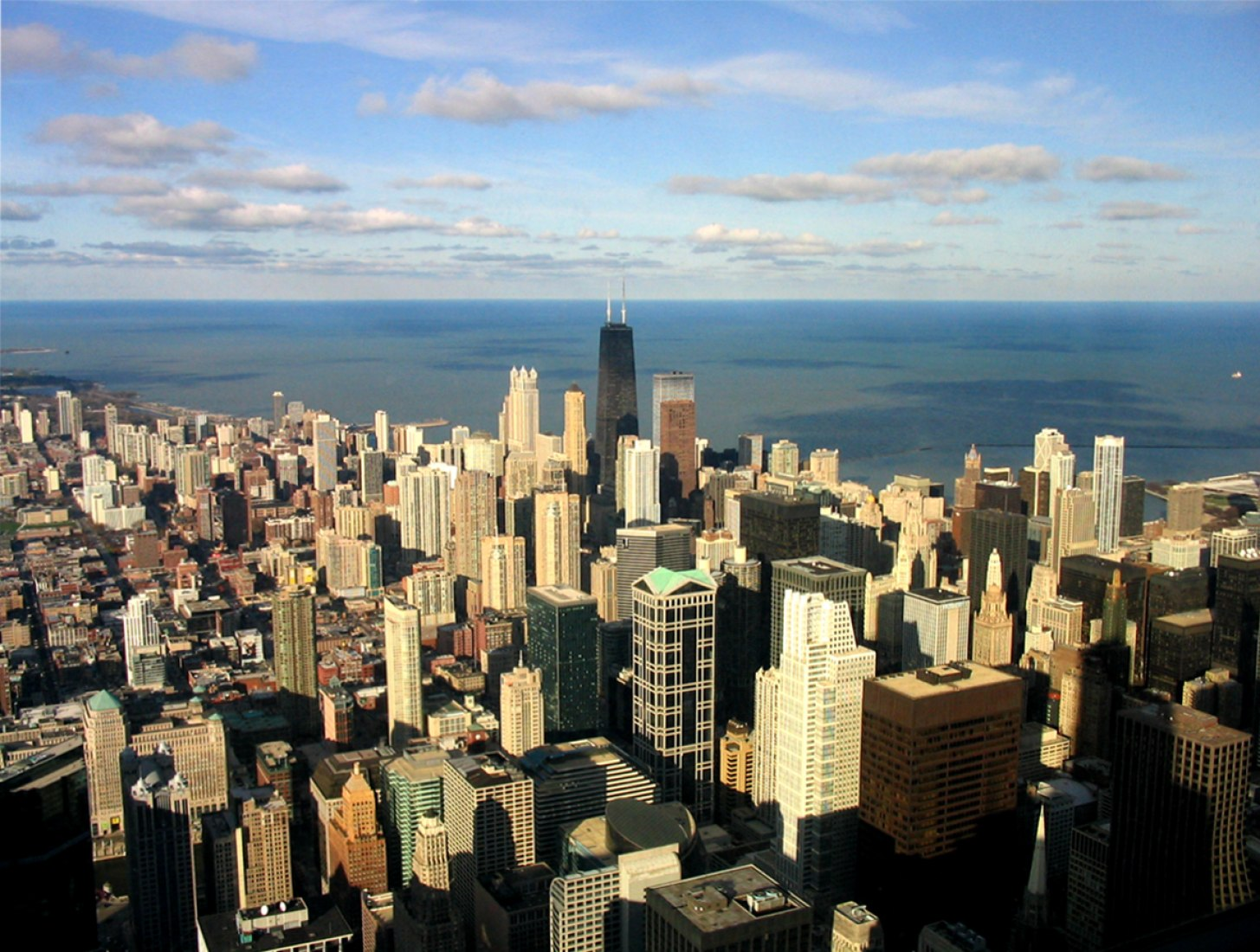Aerial view. John Hancock Center by Skidmore, Owings & Merrill, skyline of Chicago from the Sears Tower. Photography courtesy Creative Commons by Dori.