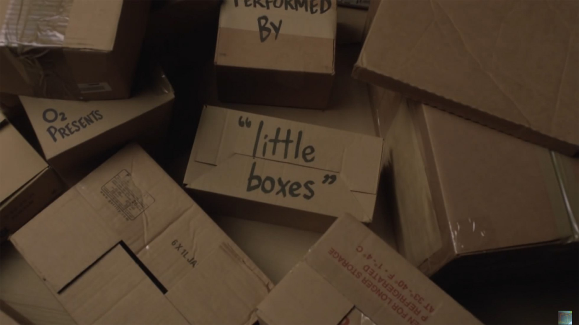 Video screenshot. Little Boxes by Walk off the Earth.