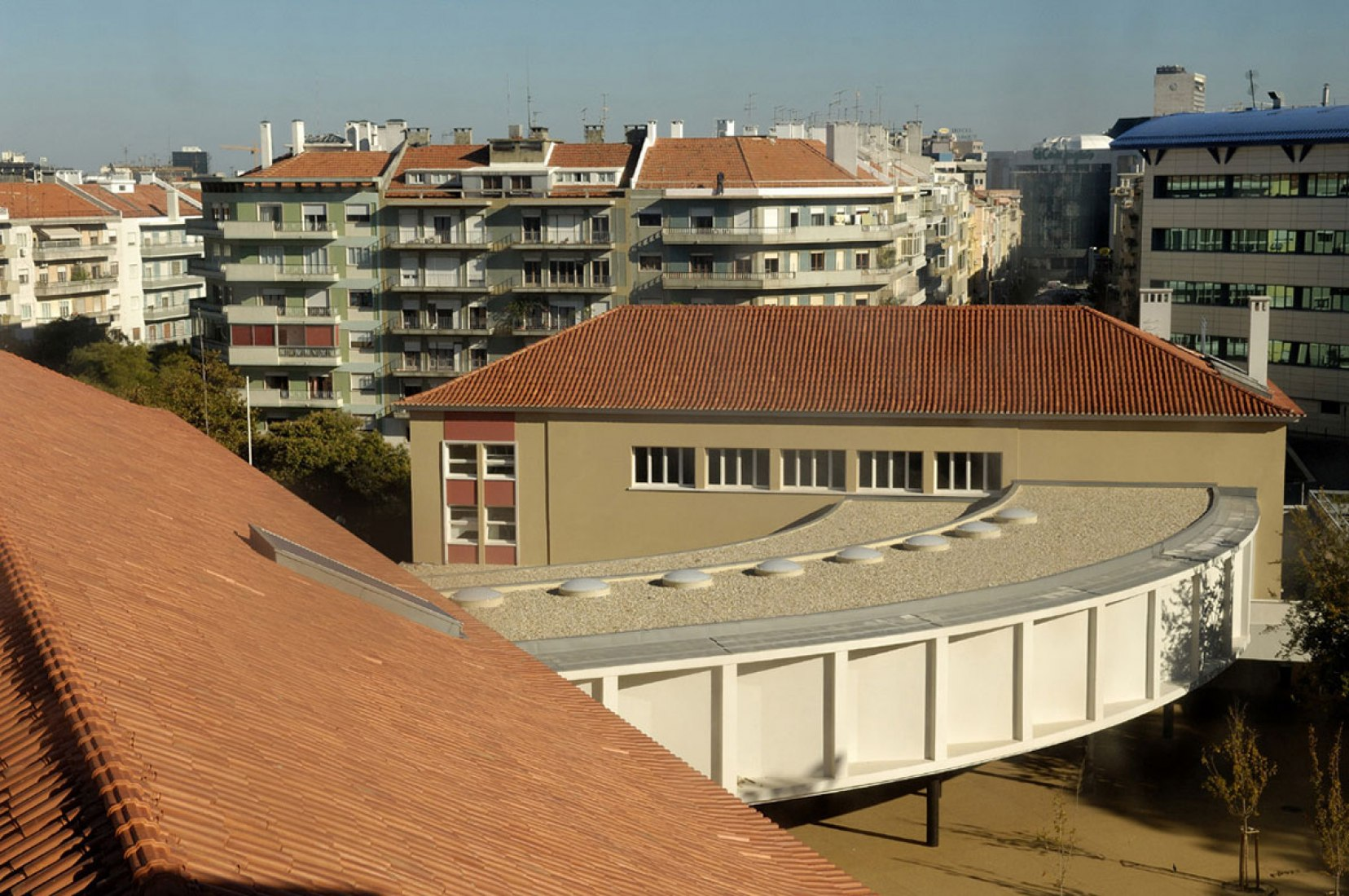 View of the restored original buildings' roofs, of the new library and of the ci