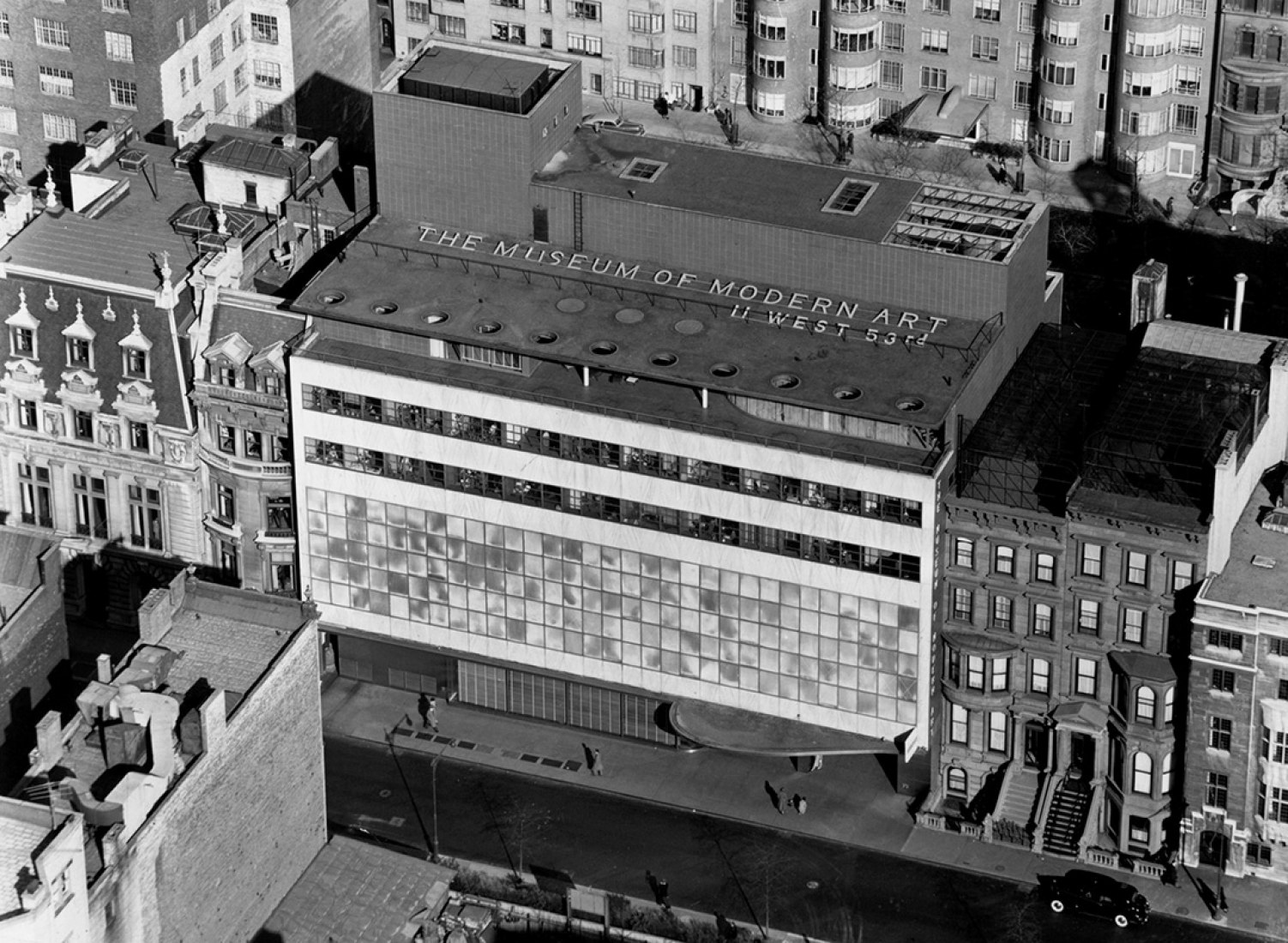 Buildings around the Museum of Modern Art, shown in 1939, have fallen to accommodate expansion, changing the scale of West 53rd Street. Andreas Feininger/Museum of Modern Art.