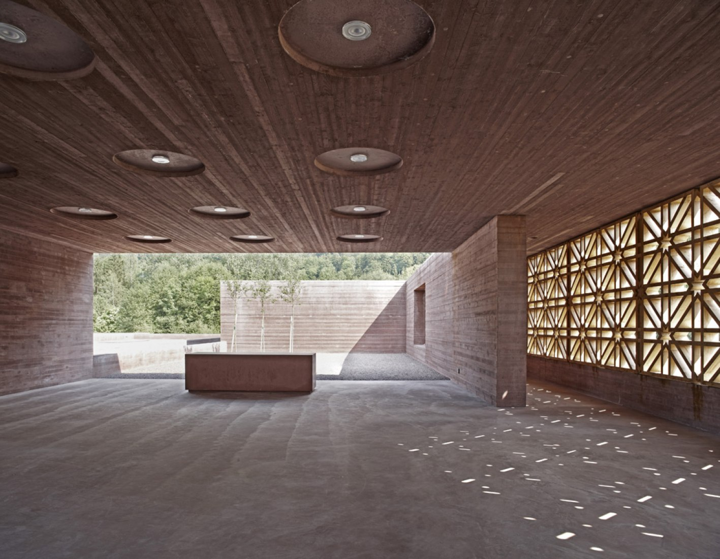 Congregation space. Islamic Cemetery. Location: Altach, Austria (Europe). Architect: Bernado Bader Architects, Dombirn, Austria. Completed: 2011. Design: 2008-2011. Site size: Ground floor area: 4'235 m² - Total site area: 8'415 m². Photograph © AKAA / Adolf Bereuter.