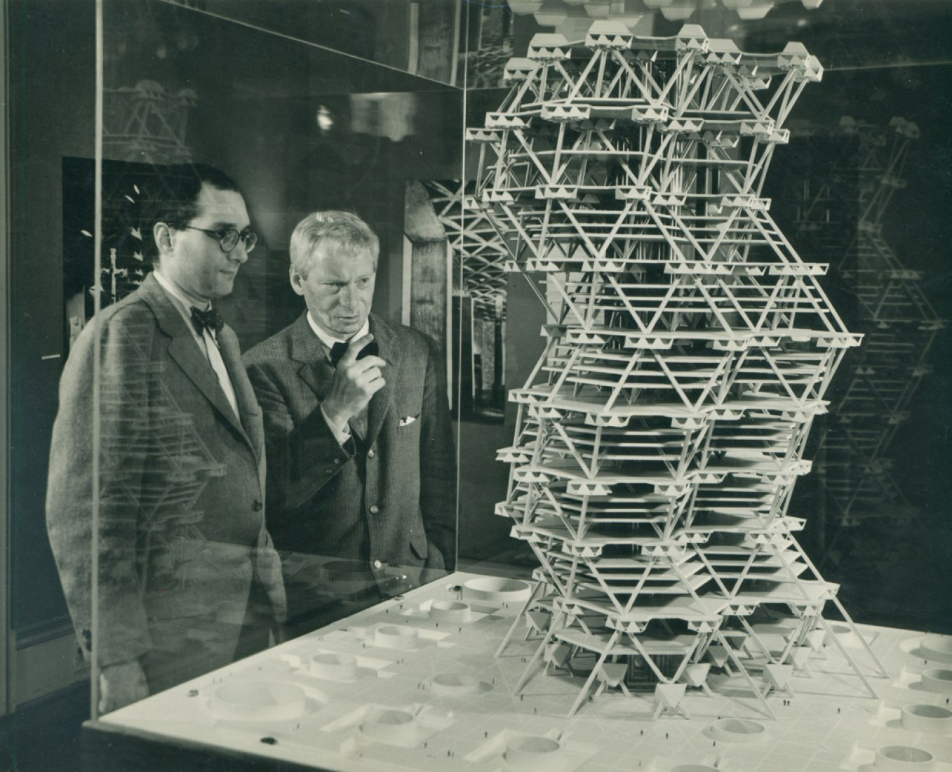 Louis Kahn and Jonas Salk with model of the City Tower at at Cornell University. Date: February 1958. Photograph by Sue Ann Kahn.