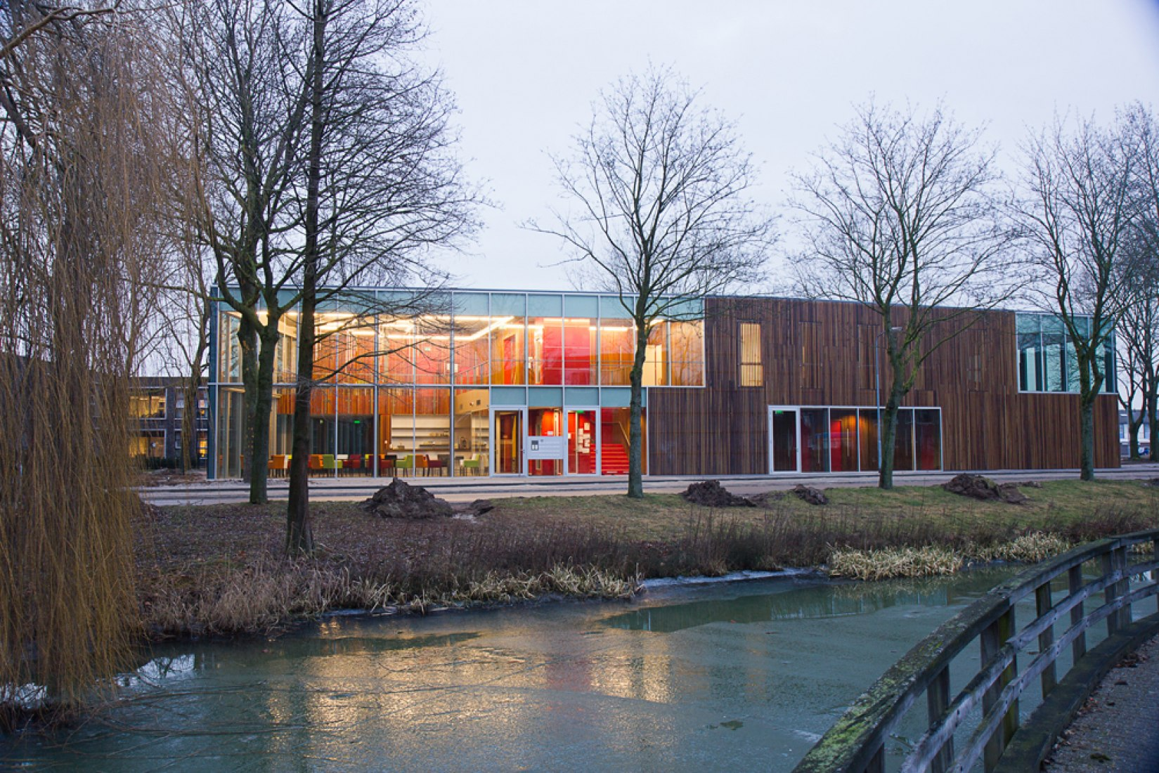 View across pond reigerpad. Huis van Droo Community Centre by JDWA.