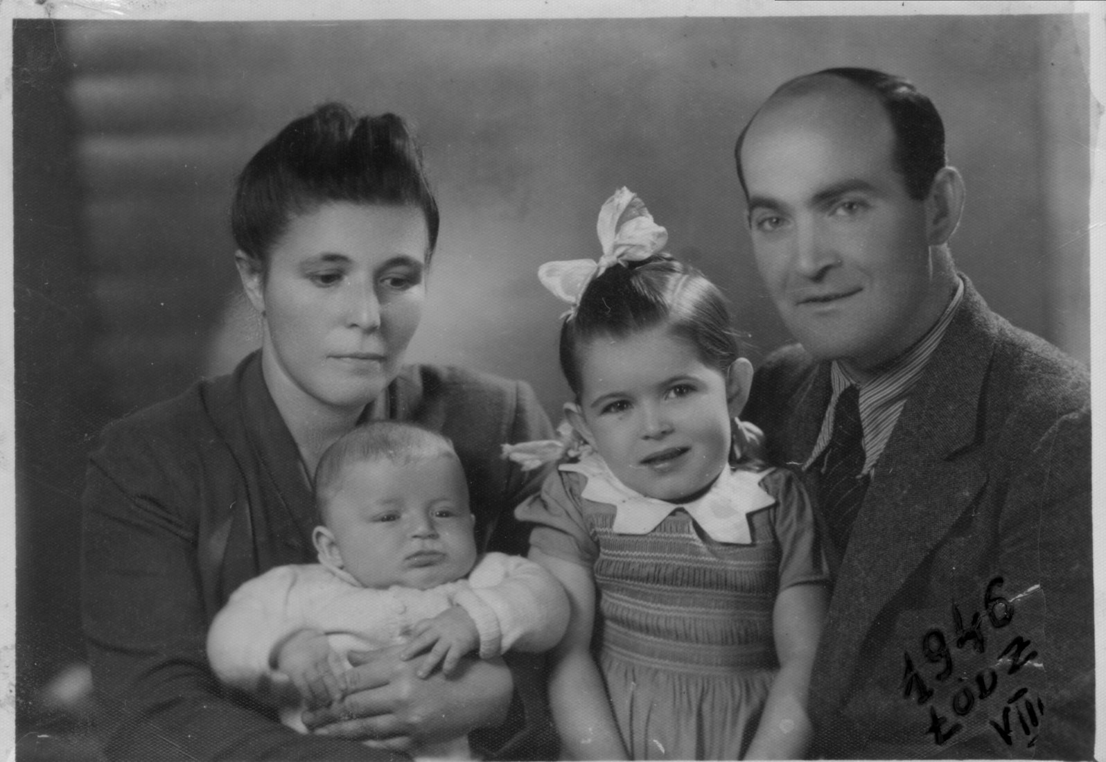 Daniel with sister Annette and Parents Dora and Nachman, 1946, Lodz. Image courtesy of Barcelona Roca Gallery.