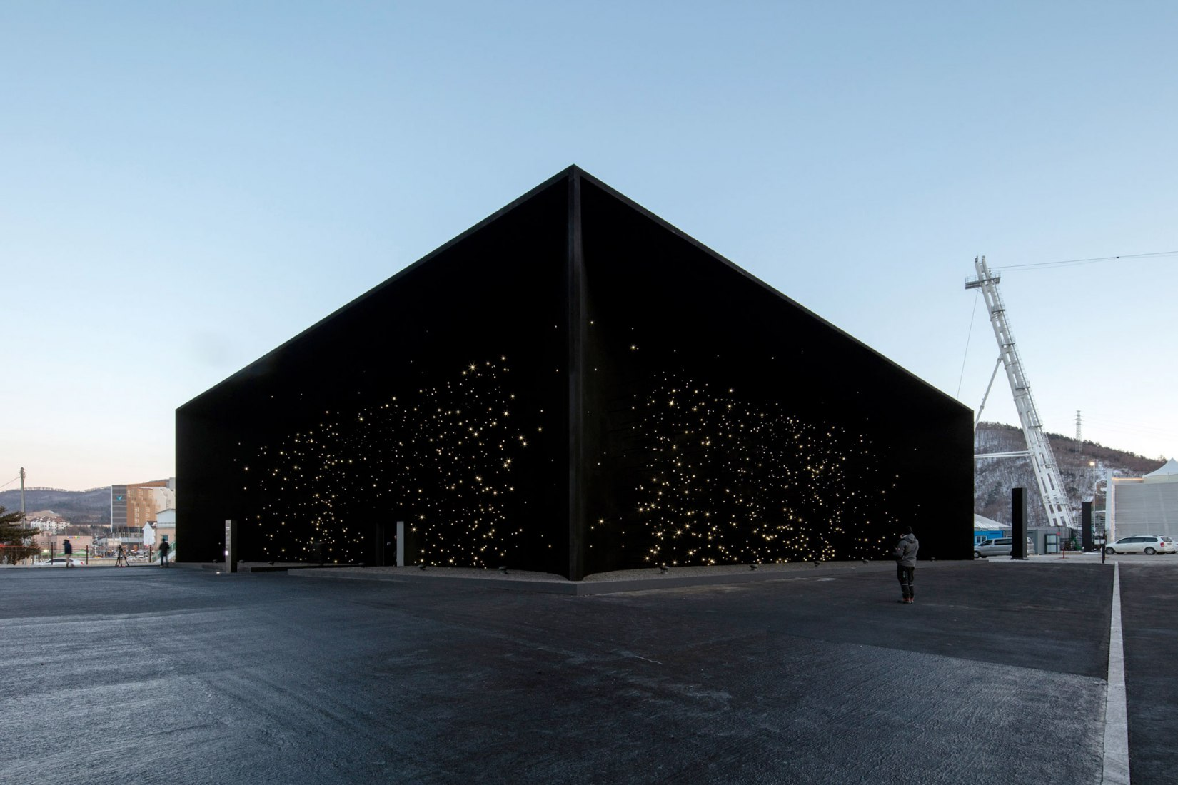 Exterior view. 'Darkest Building on Earth' pavilion by Asif Khan. Photograph © Luke Hayes