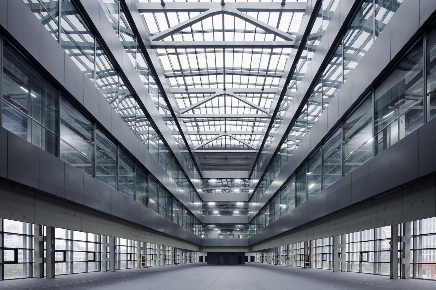 Atrium. Caohejing Xinzhou Plaza by GMP. Photograph by Hans-Georg Esch