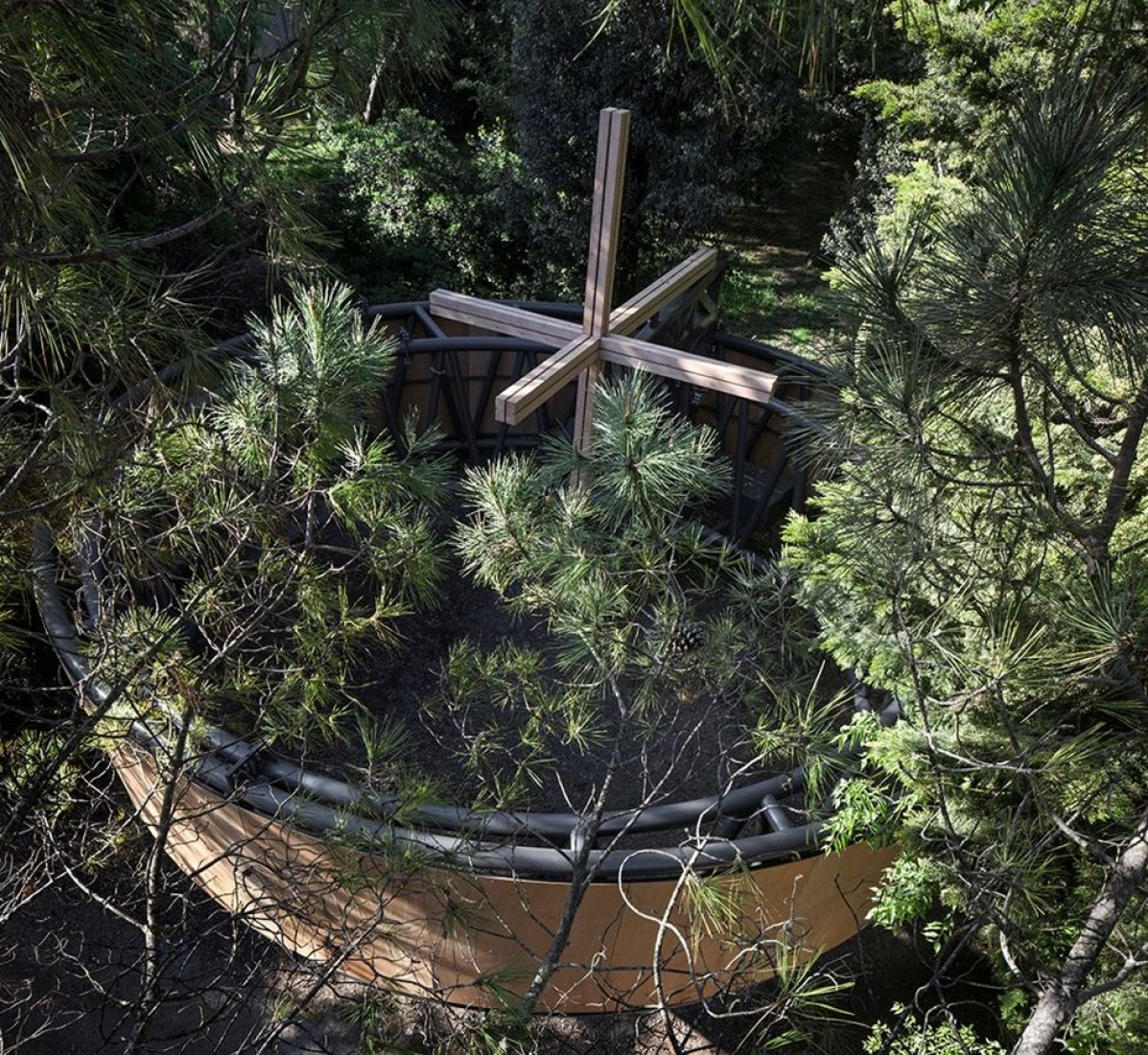 Javier Corvalán's timber Nomadic Chapel, a circle of timber, appears to unfold in the forest. Photograph by Alessandra Chemollo