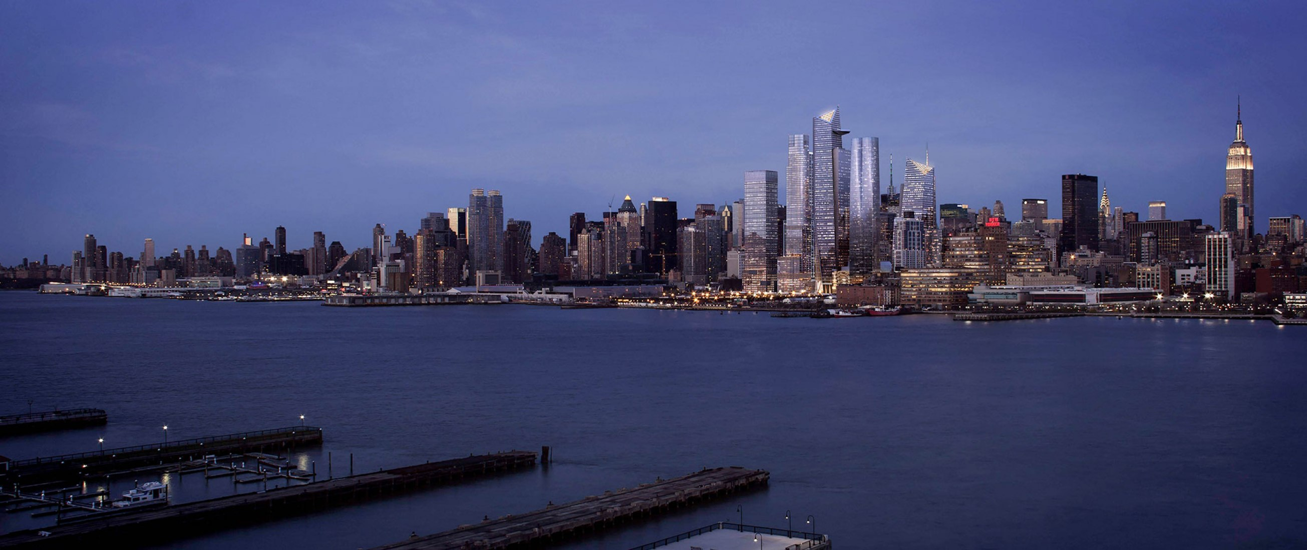 An evening view of Hudson Yards from the Hudson River. Photograph courtesy of Related Oxford.