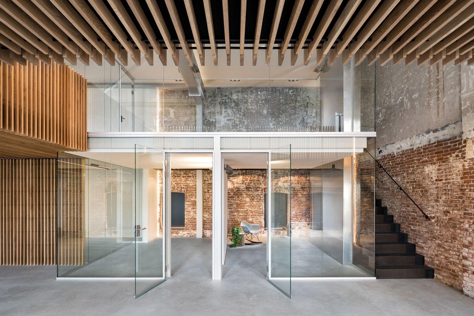 Rehabilitación de un almacén por Firm Architects. Fotografía por Studio de Nooyer