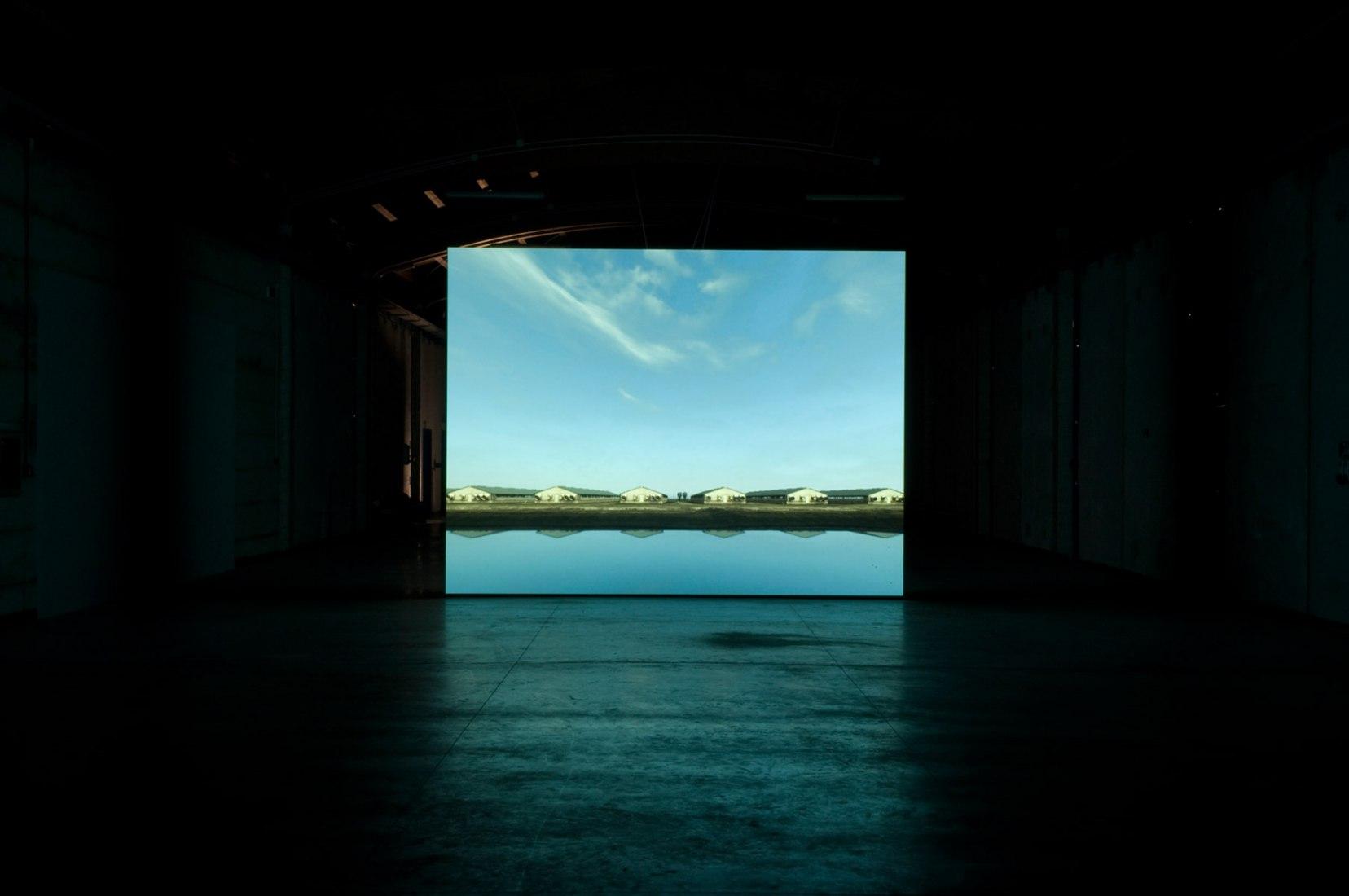 Grow Finish Unit (Near Elkhart, Kansas), 2008. Installation View, John Gerrard, Animated Scene. Isola di Certosa, Venice Biennale 2009.