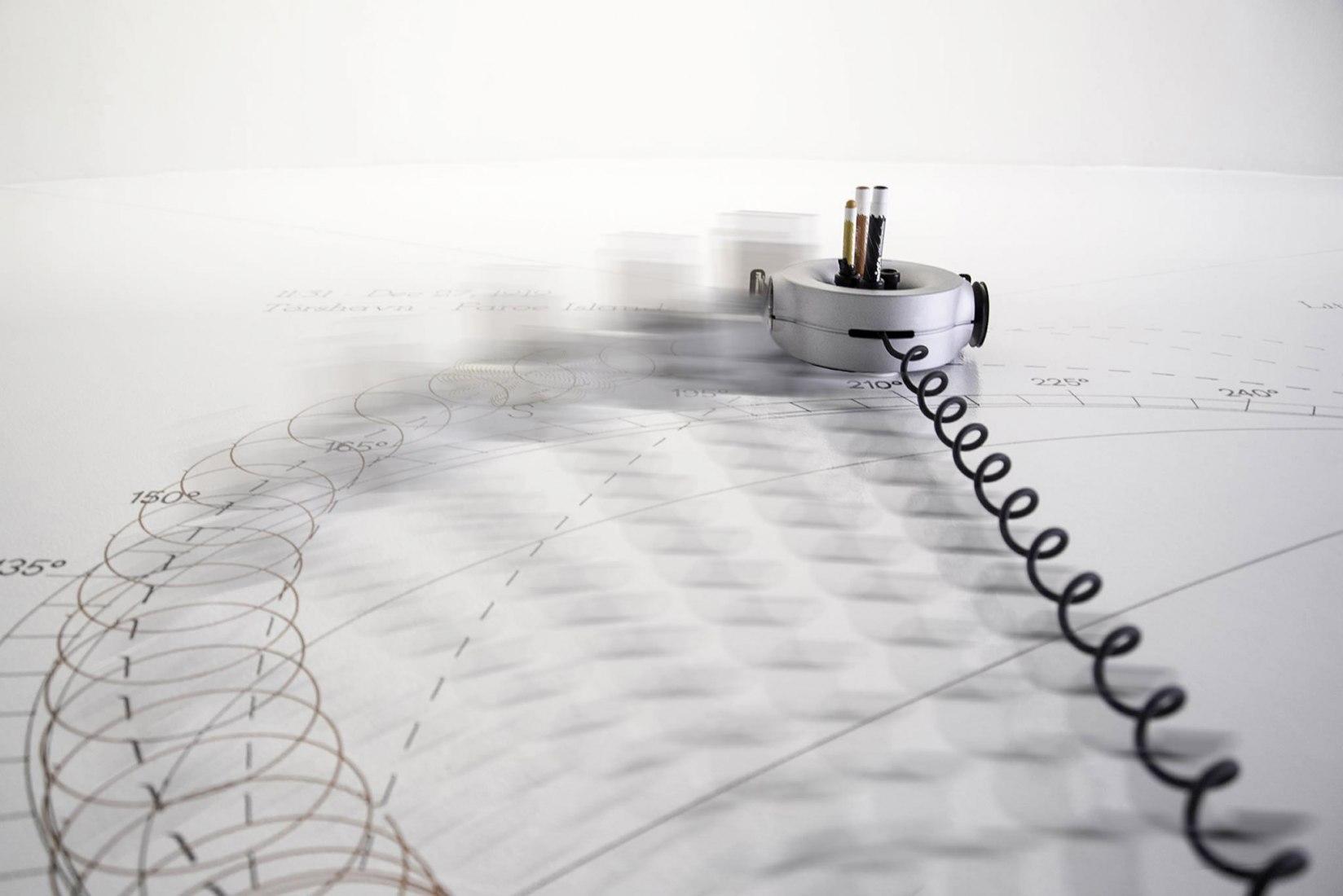Olafur Eliasson's LittleSun and Carlo Ratti's Scribit robot. Photograph by Federico Morando