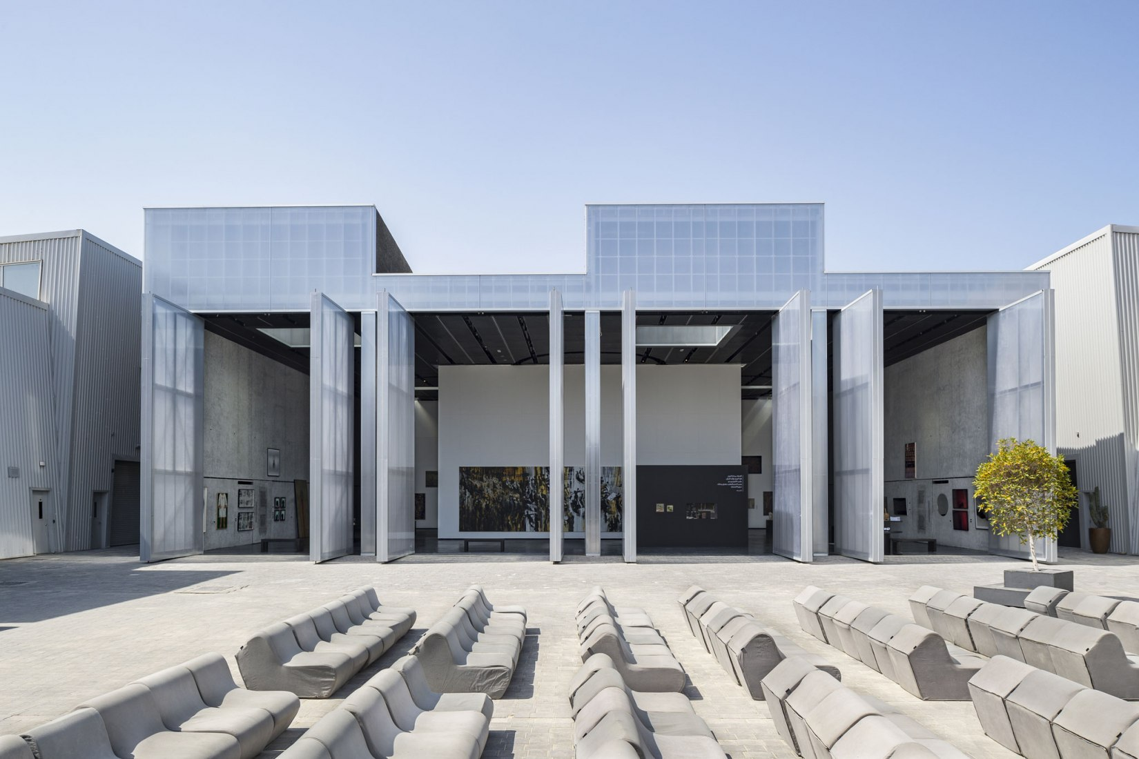 Courtyard with open doors. Concrete by OMA. Photograph © Aga Khan Trust for Culture / Cemal Emden.