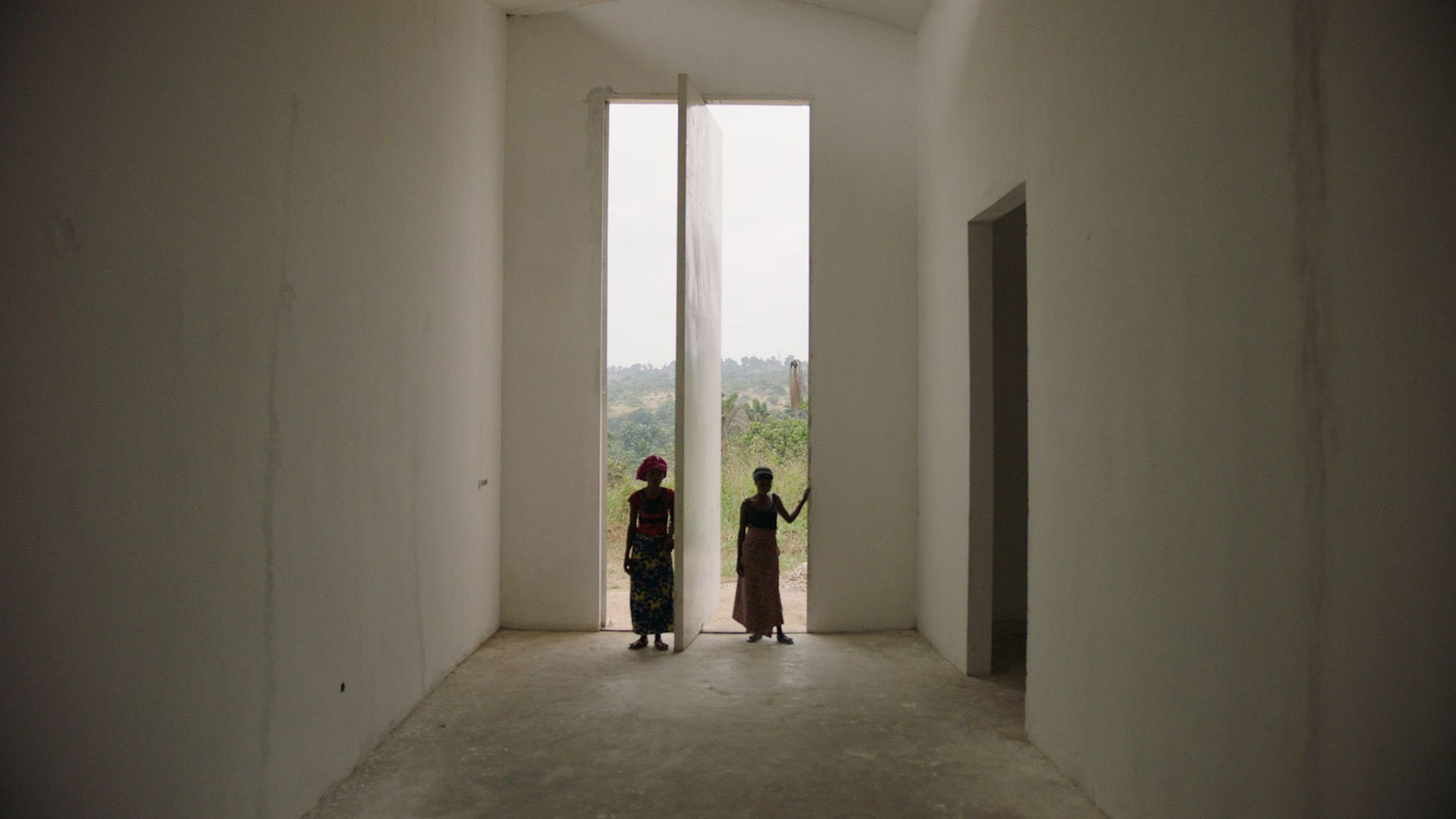 Mbuku Kimpala and Irene Kanga at entrance of White  Cube (still from White Cube, Renzo Martens) ©  Institute for Human Activities.