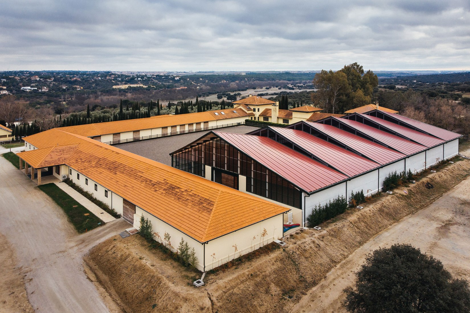 Aerial view. Horse Ridding Field in cattle Farm by OOIIO Arquitecture. Photograph of OOIIO Arquitectura, Josefotoinmo