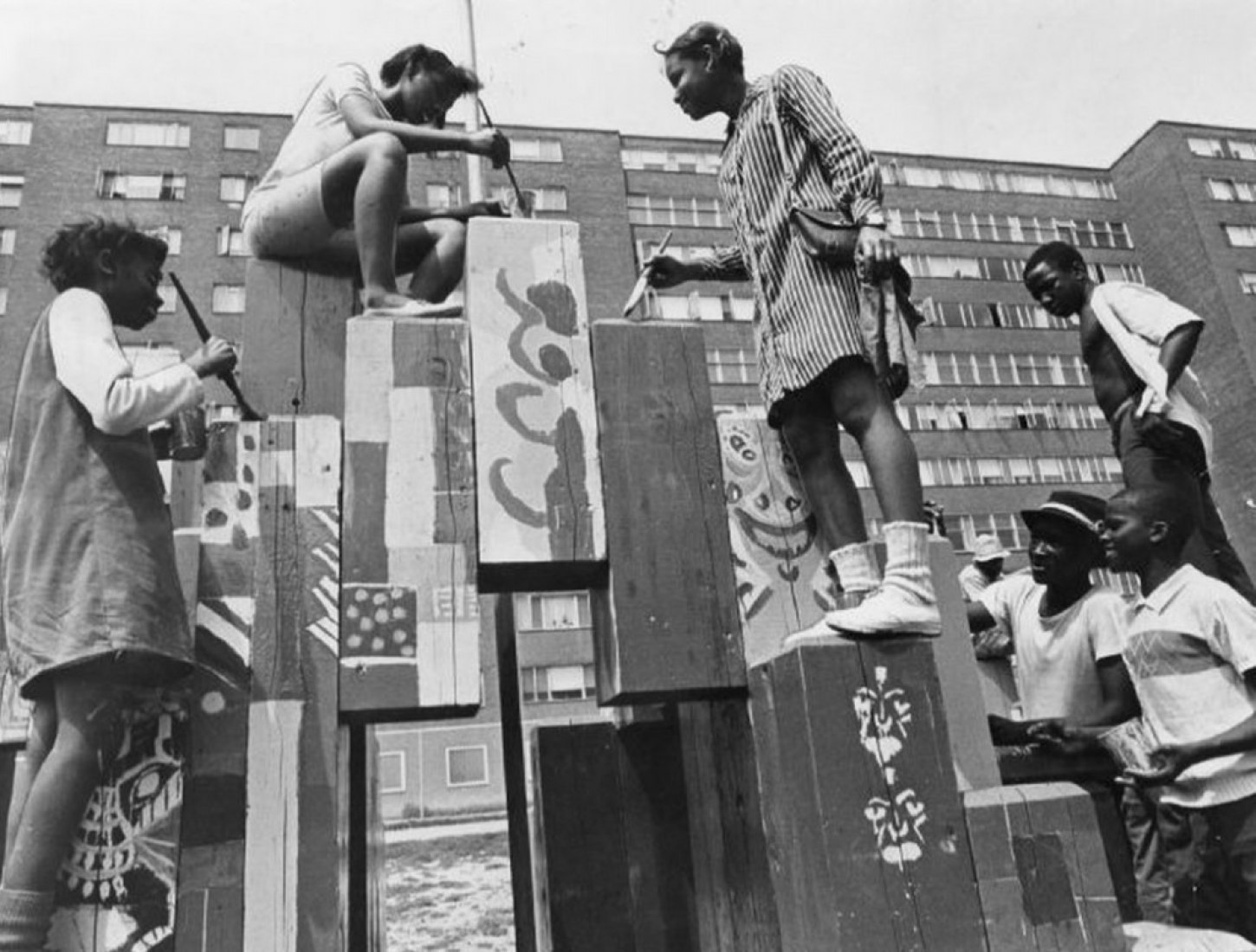 """Pruitt-Igoe"" 1968. Children painting the game area as part of a school project. Source: St. Louis Post Dispatch"