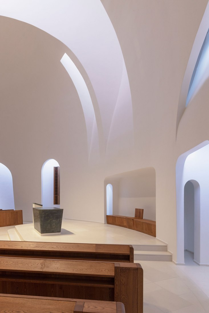 Saint John Paul II Church by Robert Gutowski Architects. Photograph by Tamás Bujnovszky.