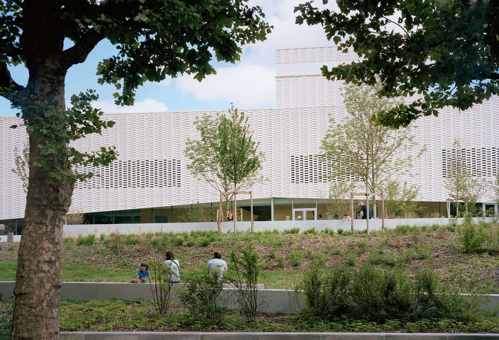 Exterior view. Theatre Jacques Carat by Ateliers O-S Architectes. Photograph by Cyrille Weiner