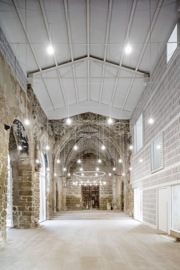 Rehabilitation of the The Ancient Church of Vilanova de la Barca by AO. Photography © Adrià Goula