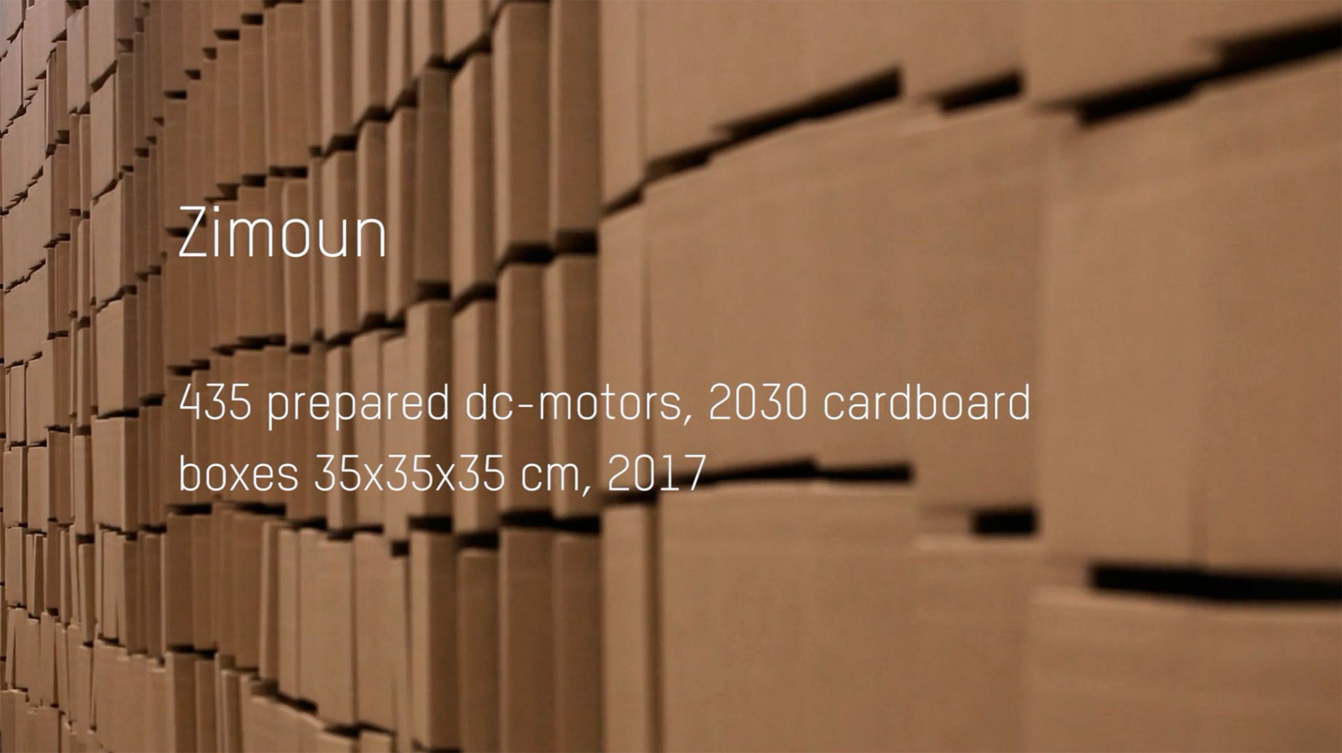435 prepared dc-motors, 2030 cardboard boxes 35x35x35cm by Zimoun. Image courtesy of Zimoun